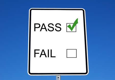 pass or fail marks on a road sign