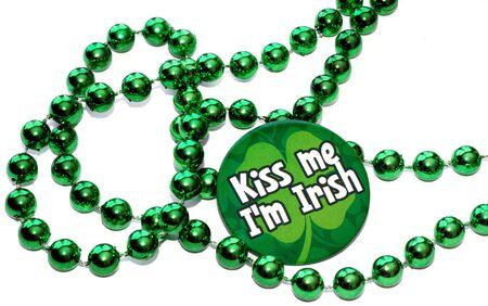 patron saint of ireland: st patricks day button around green beads