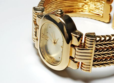 Fancy designed ladies gold wrist watch on white background Stock Photo