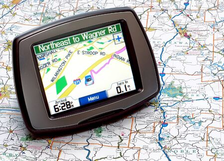 Portable GPS for a car sitting on a map