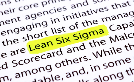 six: The words Lean Six Sigma highlighted with a yellow marker Stock Photo