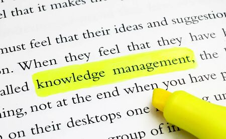 The words Knowledge Management highlighted with a yellow marker