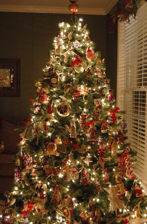 living room: Beautifully decorated Christmas tree in a living room