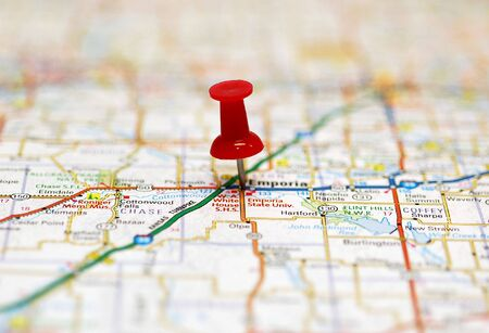 Map with red push pin marking destination Stock Photo