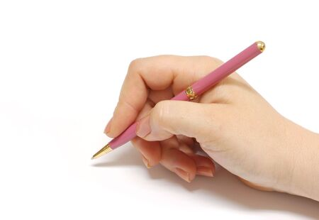 Female hand holding a pen. Great photo for contract signing needs. photo
