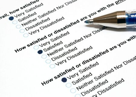 customer: Customer satisfaction survey with pen on the side