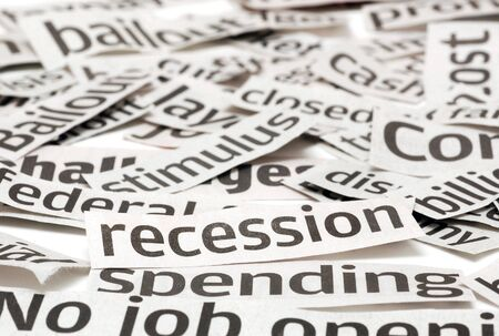News headlines on a bad economy. Focus is on the recession headline