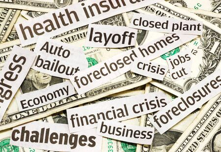 News headlines and money representing an economy in recession Stock Photo