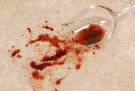 carpet: Carpet stain from a red wine spill