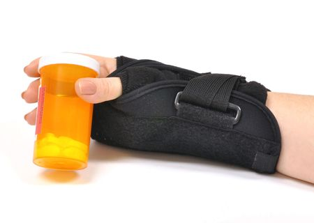 carpal tunnel: Hurt wrist with brace holding pill bottle