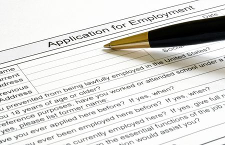 Filling out an application for employment form Stock Photo