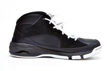 athletic wear: Single basketball shoe on a white background