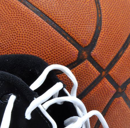 athletic wear: Macro of a basketball and gym shoes