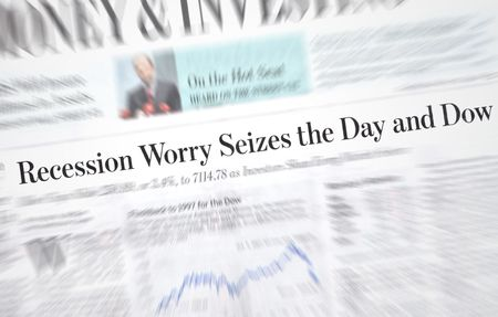 Recession headlines in an investment newspaper photo