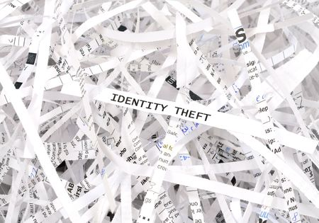 Identity theft text surrounded by shredded paper. Great concept for information protection