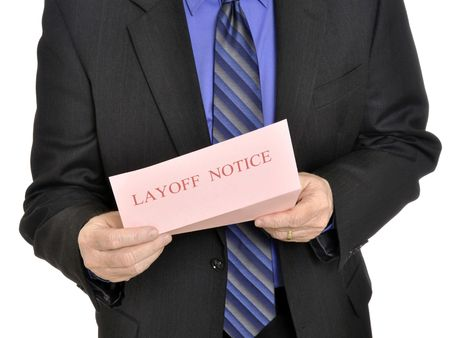 Male executive receiving the pink slip layoff notice 版權商用圖片