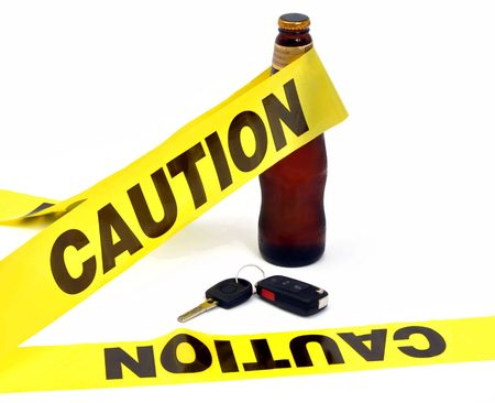 designated: Drinking and driving concept with yellow caution tape around beer and keys Stock Photo