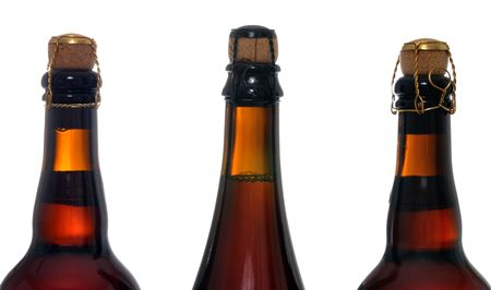 corked: Corked Belgium beer bottles on a white background Stock Photo