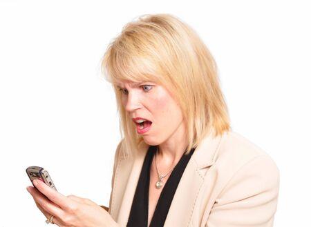 shocking: Working businesswoman receiving shocking news Stock Photo
