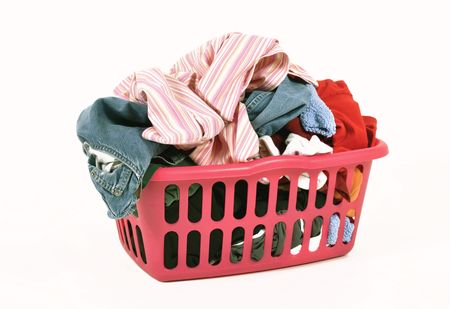 Dirty clothes in a laundry basket Stock Photo - 5319002