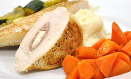 Stuffed chicken with carrots, garlic mashed potatoes and zucchini