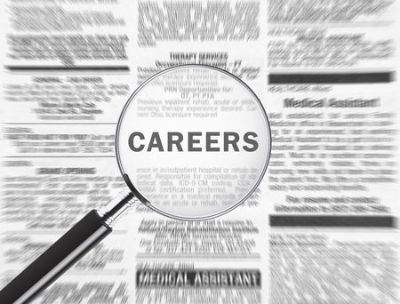 Magnifying glass over the word careers in the newspaper