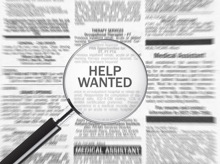Help wanted ad through a magnifying glass Stock Photo