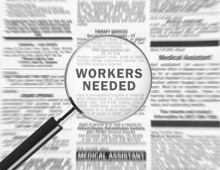 hired: Workers needed ad through a magnifying glass