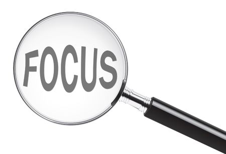 Focus concept with text under a magnifying glass