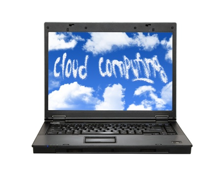 Laptop with clouds and cloud computing text Stock Photo - 8629772