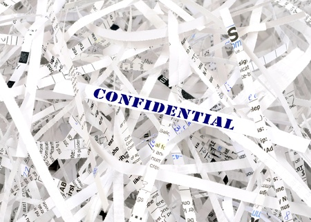 Confidential text surrounded by shredded paper. Great concept for information protection Stock Photo