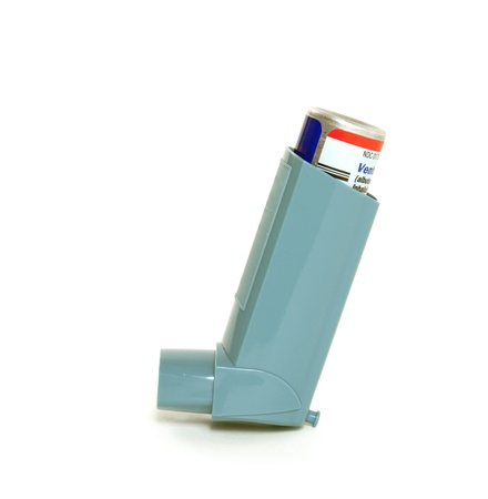 coughing: Asthma inhaler isolated on a white background Stock Photo