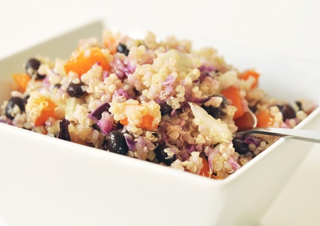 Vegetarian quinoa salad in a white bowl