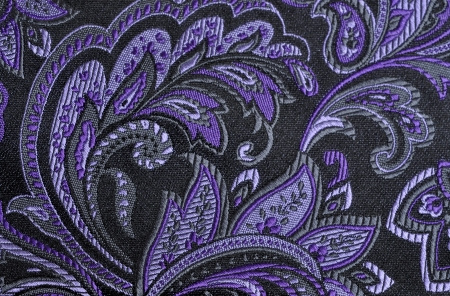 Purple paisley pattern on fabric