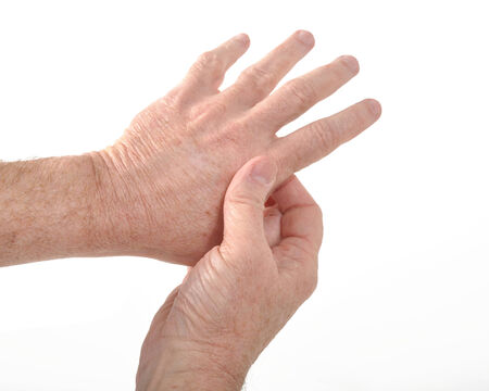 Man holding his aching thumb