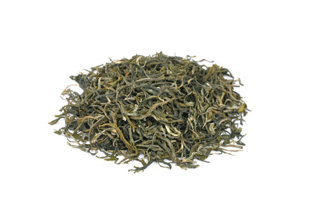 Loose green tea on white bakcground