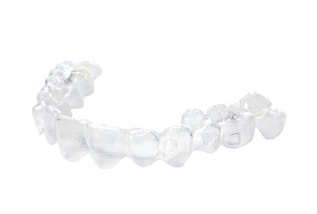 Invisible braces on a white background photo