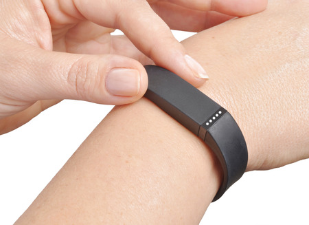 Activity tracker on a womans wrist