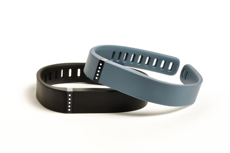 fitness gym: Activity fitness trackers on a white background Stock Photo