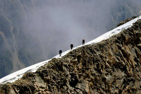 Alpinists on the comb of mountain