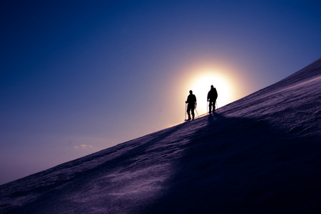 mountain snow: Two climbers are moving to the top of the glacier