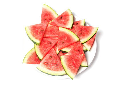 arranged slices of watermelon on a plate photo