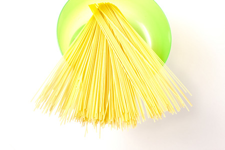 ingest: Spaghetti on a kitchen scale to be weighed