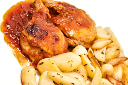 chicken with tomato sauce with potatoes photo