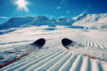 Skis in snow at Mountains Stock Photo