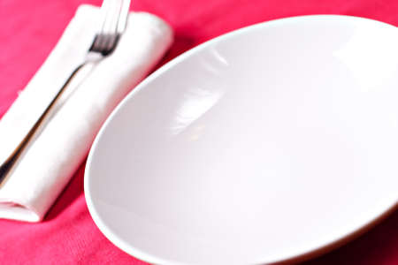 flatware: Dish and flatware on a red cloth