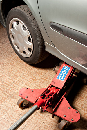 repaired: cars lifted off the ground to be repaired Stock Photo