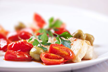 Fillet of halibut with tomatoes and olives photo