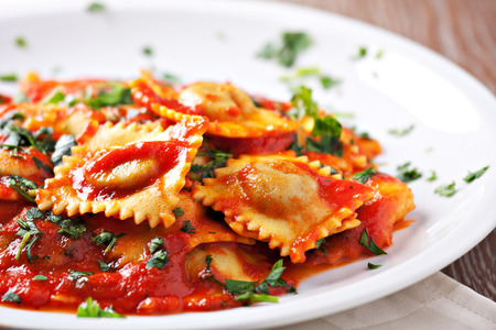 lunch meal: Ravioli with tomato sauce