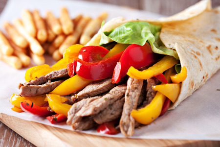 Fajitas with fries Фото со стока
